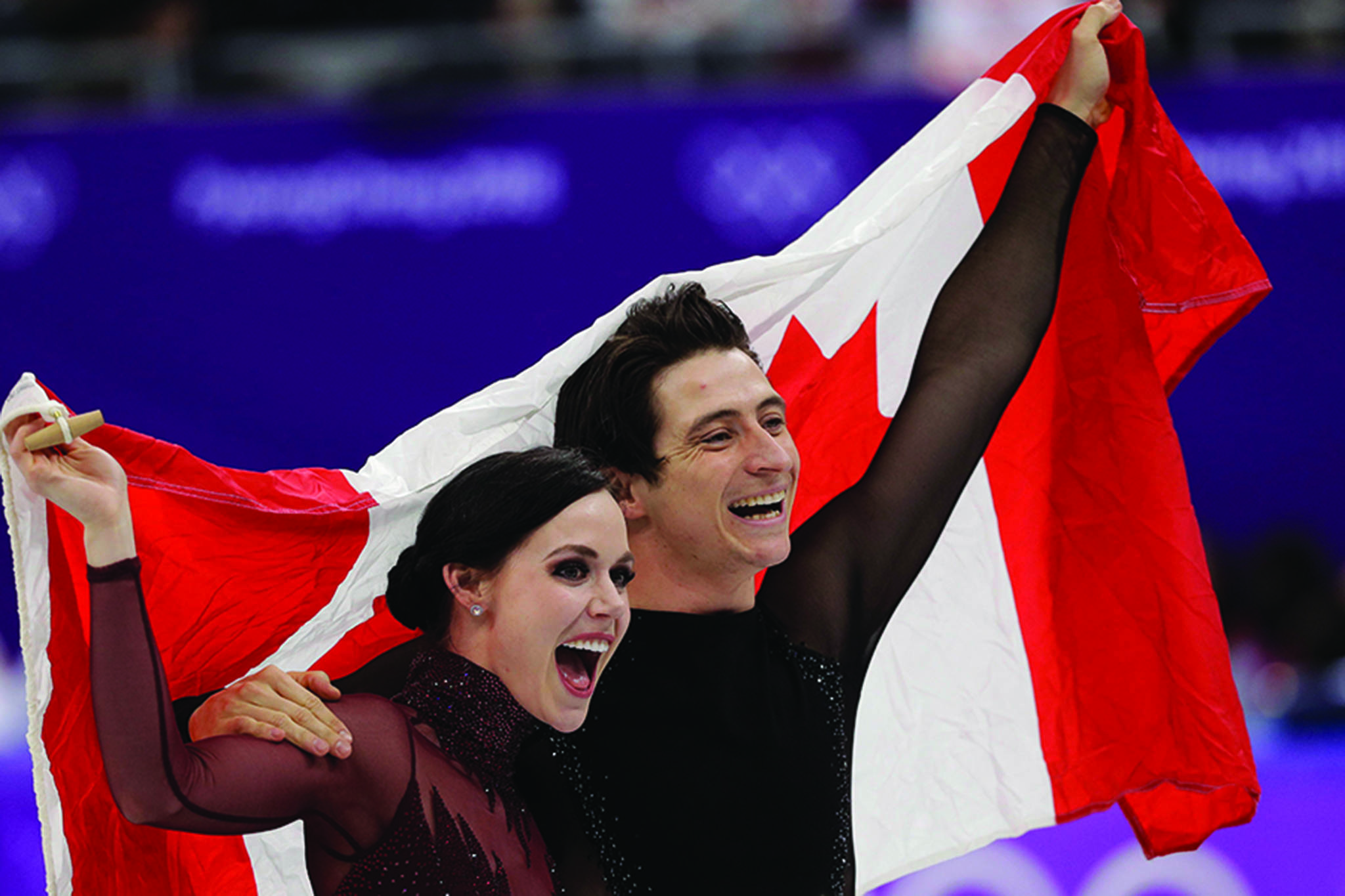 Tessa Virtue and Scott Moir of Canada celebrate during the venue ceremony after winning the ice dance, free dance figure skating final in the Gangneung Ice Arena at the 2018 Winter Olympics in Gangneung, South Korea, Tuesday, Feb. 20, 2018. (AP Photo/David J. Phillip)