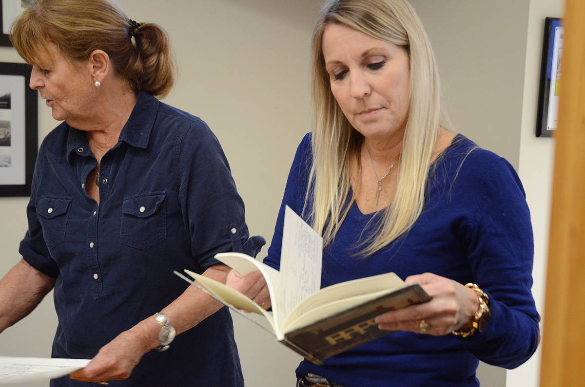 Joyce Coutts, left, former NIC admin and operation support assistant to the regional director, and Leanne Moore, NIC regional continuing education and training officer look through some of the NIC archives from the college's Port Alberni time capsule. PHOTO COURTESY NIC